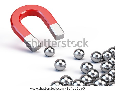 Business concept - Magnet attract spheres - stock photo