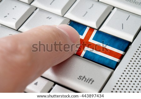 Business concept male finger pressing Iceland enter key on metallic keyboard - stock photo