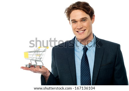Business concept - Man holding shopping cart - stock photo