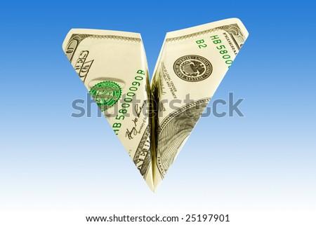 business concept. money plane over blue sky - stock photo