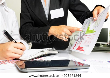Business concept of a woman explaining business strategy.