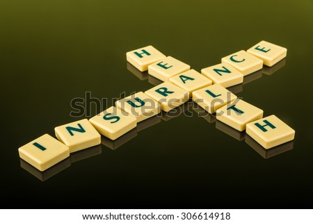 Business concept of medical health insurance using letter blocks - stock photo
