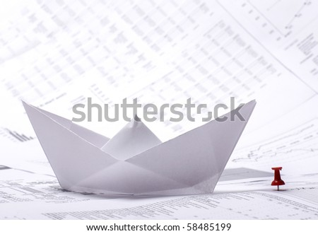 Business concept of paper boat and documents - stock photo