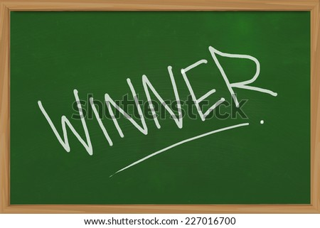 Business concept of Winner word written with chalk on blackboard