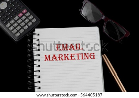 Business Concept - Office desk with equipment and text written Email Marketing