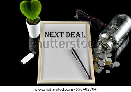 Business concept - Office table with equipment and text written Next Deal