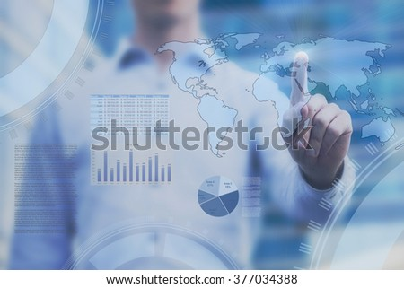business concept on touch screen, global trading analytics, dashboard with world map and abstract infographics - stock photo