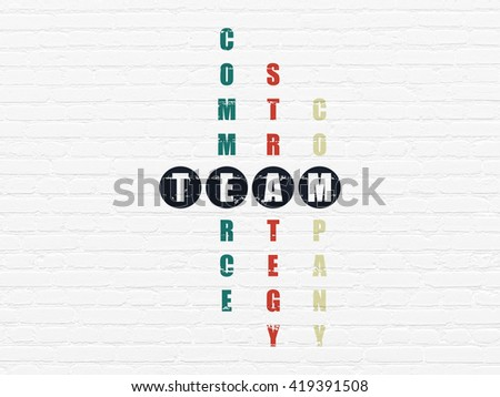 Business concept: Painted black word Team in solving Crossword Puzzle - stock photo