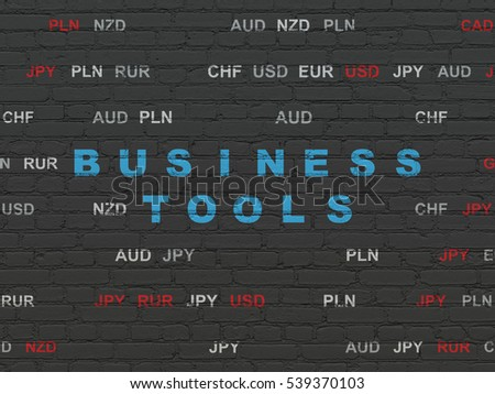 Business concept: Painted blue text Business Tools on Black Brick wall background with Currency