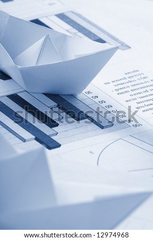 Business concept, paper boat and documents