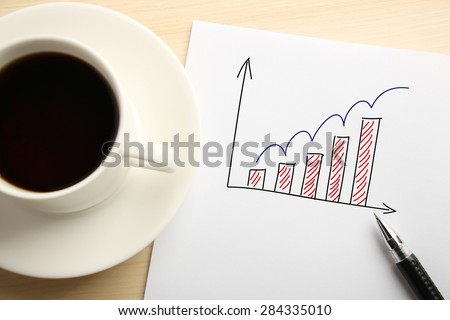 Business concept paper is on the desk with a cup of coffee and a ball pen aside. - stock photo
