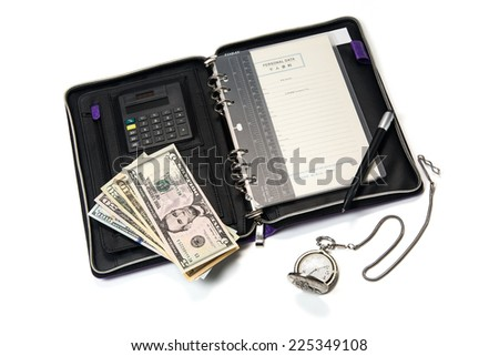 Business concept photo of organizer with pen, dollars and clock isolated on white background - stock photo