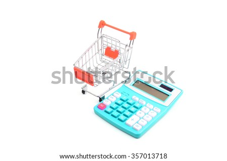 Business concept. shopping concept - trolly and calculator - stock photo