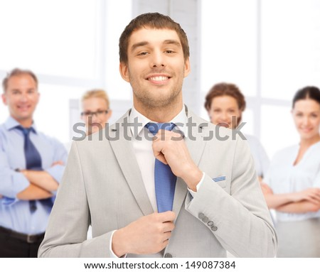 business concept - successful businessman with team in office - stock photo