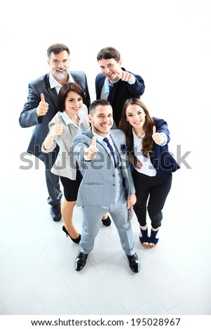 business concept - Top view of successful young business people showing thumbs up