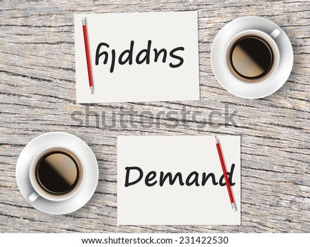 Business Concept : Two Coffee, Papers And Pencils On The Table Facing Each Other Head To Head To Compare Between Demand And Supply. - stock photo