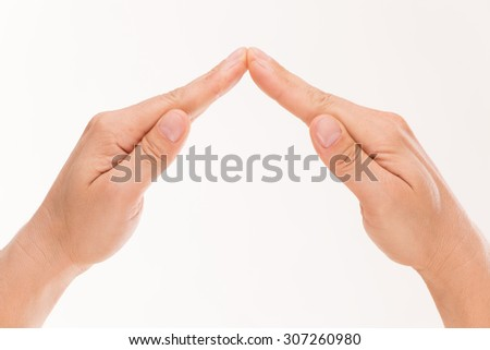 Business concept. Two tight and left hands making roof of building, business, strategies, etc. Feel confident about the future! - stock photo