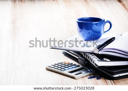 Business concept with agenda and coffee cup. Copy space  - stock photo