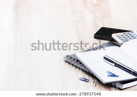 Business concept with agenda, mobile phone and calculator. Copy space - stock photo