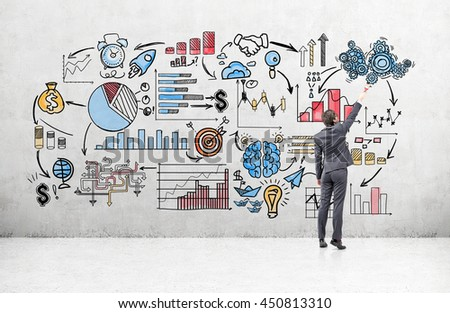 Business concept with businessman drawing business sketch on concrete wall in room - stock photo