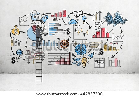 Business concept with businessman standing on ladder and drawing business sketch on concrete wall in room - stock photo