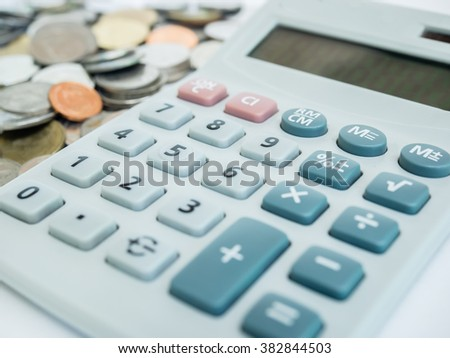 Business concept with calculator and coins.
