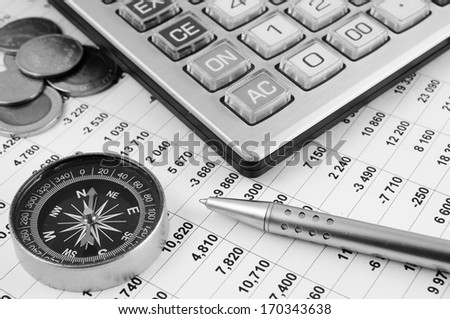 Business concept with calculator and compass  - stock photo