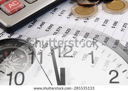 Business concept with calculator, clock and compass