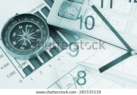 Business concept with calculator, clock and compass on documents - stock photo