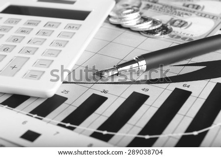 Business concept with calculator, glasses, money and documents