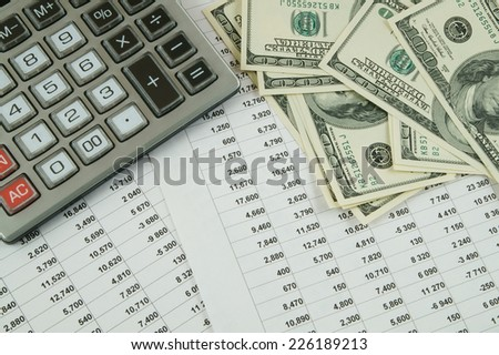 Business concept with calculator, money and documents