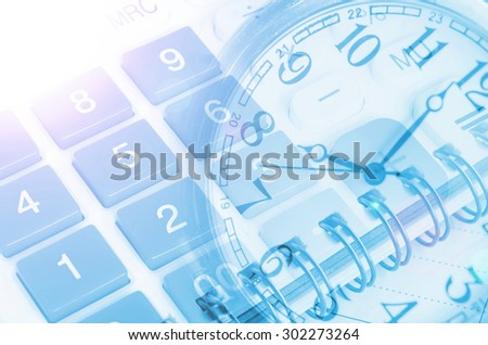 Business concept with clock, calculators and documents - stock photo