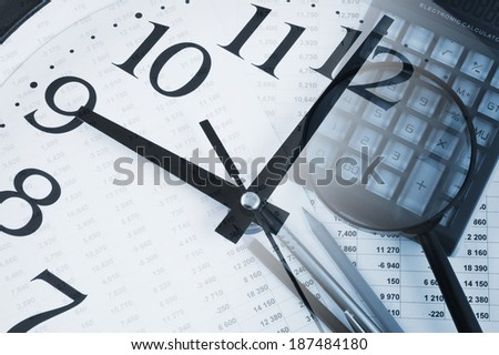 Business concept with clock, magnifying glass, calculator and documents  - stock photo