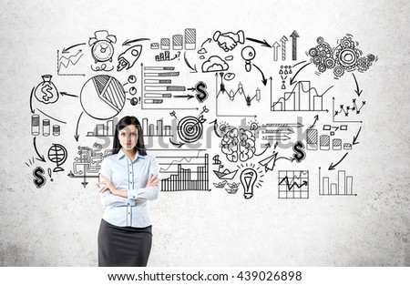 Business concept with confident businesswoman standing against concrete wall with sketch  - stock photo