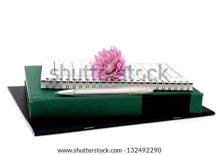 Business concept with notebook, flower and pen - stock photo