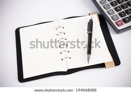 Business concept with notebooks and calculator - stock photo