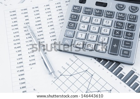 Business concept with pen, calculator and documents