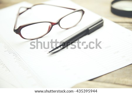 Business concept with  pen,glasses and financial documents. - stock photo