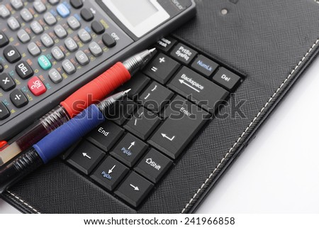 Business concept with pen ,keyboard and calculator, stock photo.