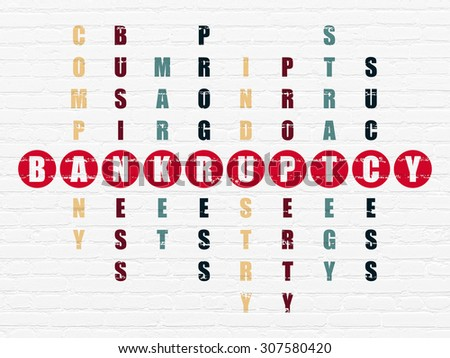 Business concept: word Bankruptcy in solving Crossword Puzzle - stock photo