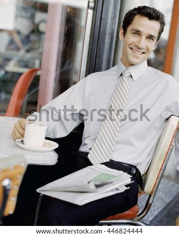 Business concept - young businessman relaxes