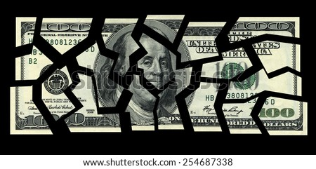 business concepts. cut the money on a black background - stock photo