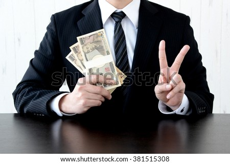 Business concepts, earning Japanese money - stock photo