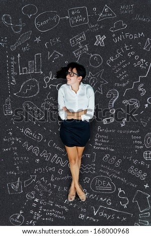 business conceptual background: woman thinking on a project - stock photo
