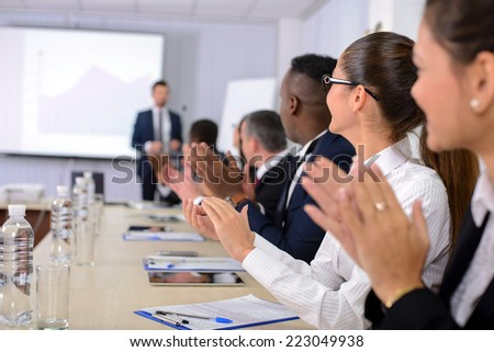 Business conference. Business meeting. Business people in formalwear discussing something while sitting together at the table - stock photo
