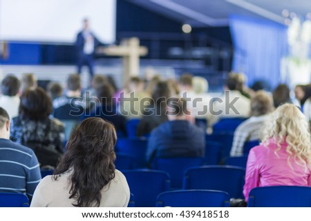 Business Conferences Concept and Ideas. Male Professional Lecturer Speaking In front of the Group of People. Horizontal Image Composition. - stock photo
