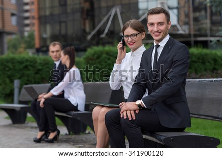 Business confidence and partnership. Business portrait of two young confident and successful business partners working  on the project. Business team at work. Business background