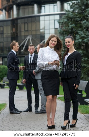 Business confidence. Portrait of two motivated businesswoman. Female colleagues  at work. Outdoors business concept