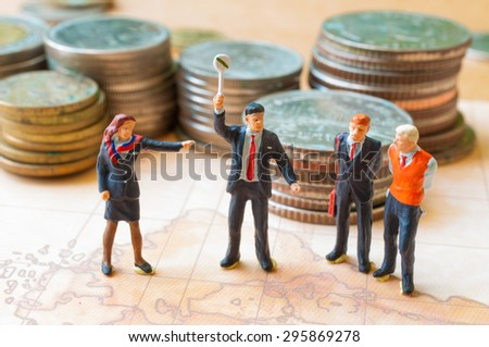 Business conflict.miniature people in formal wear arguing - stock photo