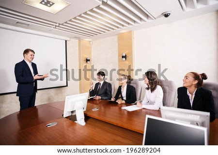 Business consultant answering a question during a meeting at office - stock photo